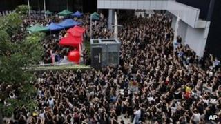 Thousands of protesters, parents, and their children gather outside the government headquarters in Hong Kong on Monday 3 Sep 2012