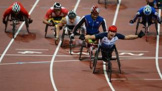 David Weir celebrates as he crosses the line