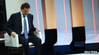 Spanish Prime Minister Mariano Rajoy sits on a chair to get ready for an interview on national Spanish public television