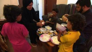 Qadour family eating
