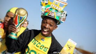 A South African football fan cheers as he waits for the opening ceremony of the 2010 football World Cup in June 2010