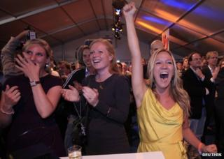 Supporters of the centre-right VVD party cheer in The Hague on election night, 12 September