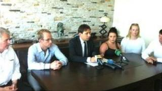 Lawyer Baris Kaska, wearing suit, with relatives of Marion Graham and Cathy Dinsmore