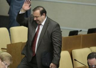 Gennady Gudkov leaves the Russian parliament in Moscow, 14 September