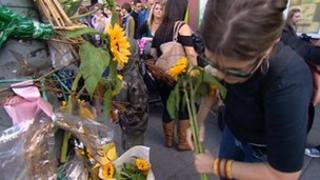 People lay flowers in memory of Hope Fennell