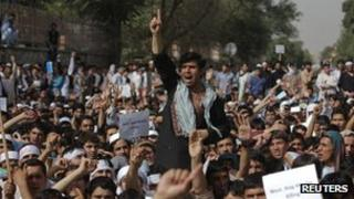 Afghan protesters shout slogans during a demonstration in Kabul on Sunday