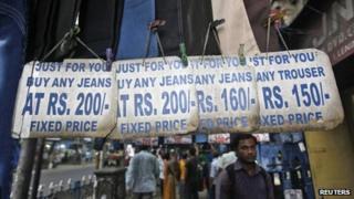 People shop for clothes at a roadside market in Kolkata on 15 September 2012