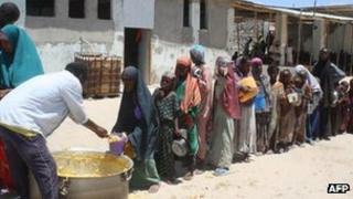 Children queue for food aid in Somalia