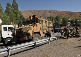 Turkish troops check the site of an attack in Bingol province, 16 September