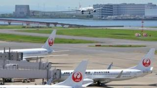 Japan Airlines jets are parked at Tokyo's Haneda airport
