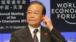 Chinese Premier Wen Jiabao prepares to deliver his keynote address at the World Economic Forum in Tianjin on September 11, 2012