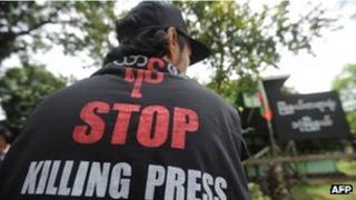 File photo (August 2012) of a Burmese journalist waiting outside court during libel proceedings against The Voice Weekly