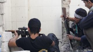 Syrian rebels crouch in Aleppo, 18 September