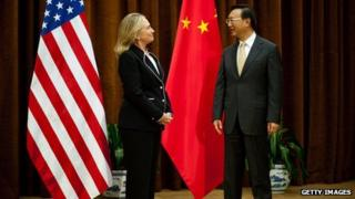 US Secretary of State Hillary Clinton (L) is greeted by Chinese Foreign Minister Yang Jieche at the Ministry of Foreign Affairs in Beijing