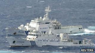 A Chinese marine surveillance ship cruises next to a Japan coast guard patrol ship in the East China Sea, 24 September 2012
