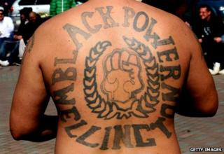 Man with tattooed back