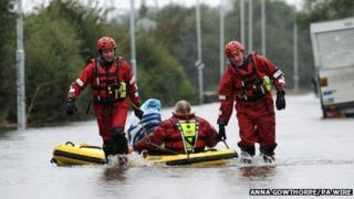 Firefighters rescue stranded motorists from a flooded road outside Castleford, West Yorkshire. Photo: Anna Gowthorpe/PA Wire