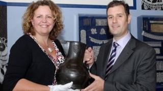 Det Insp Martin Peters handing back the Wenlock Jug to Karen Perkins