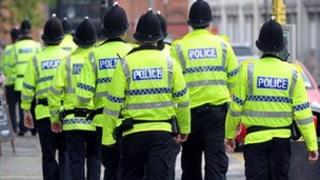 Police officers in high-visibility coats