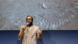 Will.i.am singing at Nasa's lab