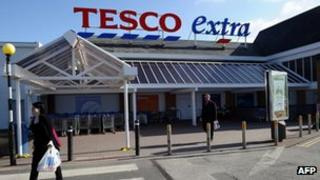 Customers outside a Tesco Extra