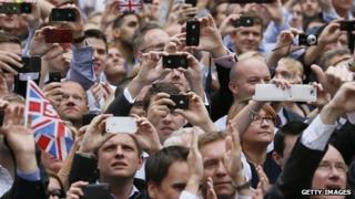 Crowd holding smart phones