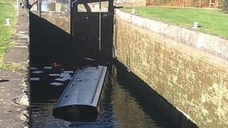 Sunken narrow boat in Caen Hill locks in Wiltshire