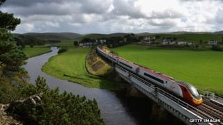 A Virgin train passes along the West Coast Main Line route near Abington on 29 August