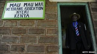 Daniel Mathenge Ndeguda, 79, stands on November 4, 2011 at the entrance of the offices of the Mau Mau War Veterans Association in the central town of Nyeri, Kenya
