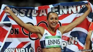 Jessica Ennis celebrates after winning gold in the heptathlon
