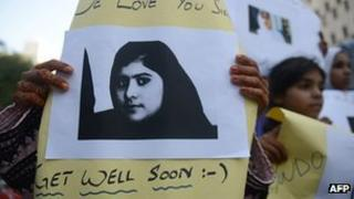 Pakistani demonstrators carry photographs of gunshot victim and child activist Malala Yousafzai. File pic: 11/10/2012