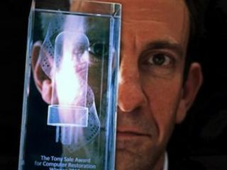Dr David Link with award