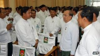 President Thein Sein (second from R) greeting USDP party members in Naypidaw, 14 October 2012