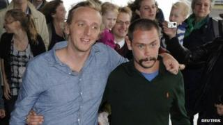 Swedish reporter Martin Schibbye and photographer Johan Persson (R) arrive at Arlanda airport in Stockholm September 14, 2012.