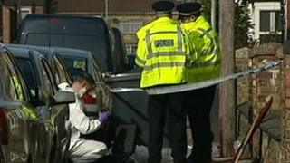 Forensic teams and police at the scene of a double stabbing in Peterborough