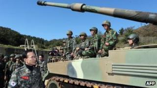South Korean President Lee Myung-Bak (L) talking with marines at Yeonpyeong Island, 18 October 2012
