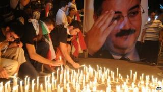 Lebanese mourners light candles during a vigil for Brig. Gen. Wissam al-Hassan and at least seven others who were killed in a Friday bomb attack in Beirut
