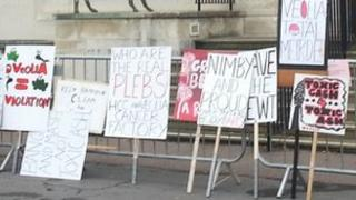 Protesters placards outside county hall