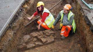Archaeologists in a trench at Northampton Station