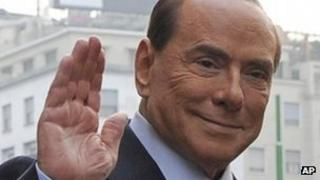 Silvio Berlusconi arrives at a court hearing on 19 Oct 2012