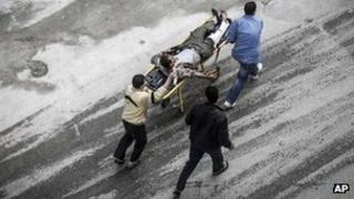 Residents wheel an injured man to hospital in Aleppo, 23 October 2012