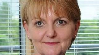 Prisons chief Sue McAllister said she will work with the Equality Commission to address the low numbers Catholics applying to join the service