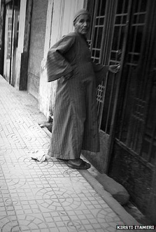 A doorman going into a building in Cairo