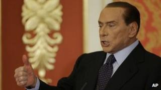 Former Italian Premier Silvio Berlusconi talks during a press conference in Gerno, near Milan, on 27 October.