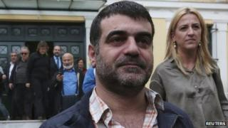 Greek editor Costas Vaxevanis (C) leaves a prosecutor's office in Athens October 28