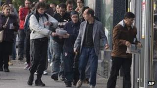People queuing at a Spanish unemployment office