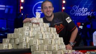 Greg Merson poses with stacks of cash and his championship bracelet in Las Vegas. Photo: 31 October 2012