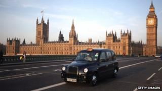Black cab in front of Westminster