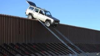 Suspected smugglers' car is stuck on US-Mexico border