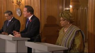 David Cameron, flanked by Liberian President Ellen Johnson Sirleaf and Indonesian president Susilo Bambang Yudhoyono.